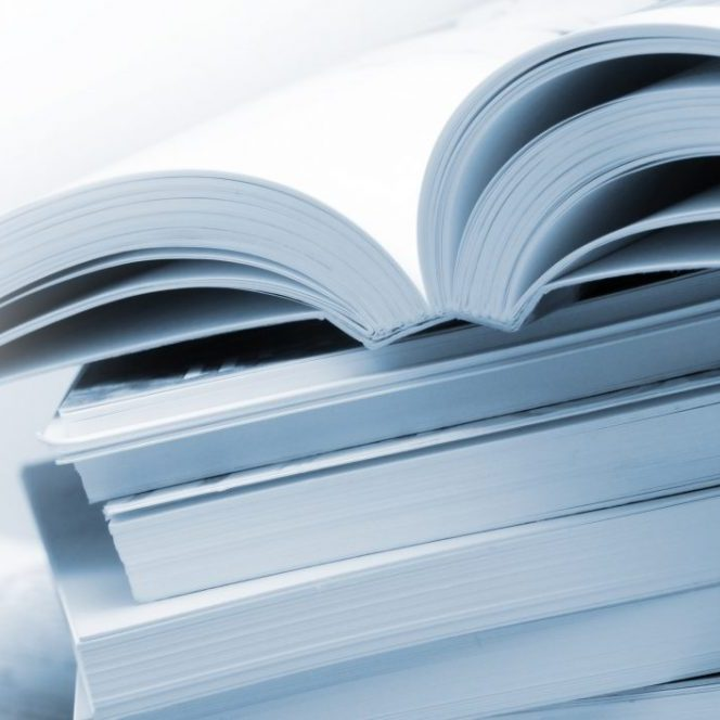 Stack of brochures in blue toned
