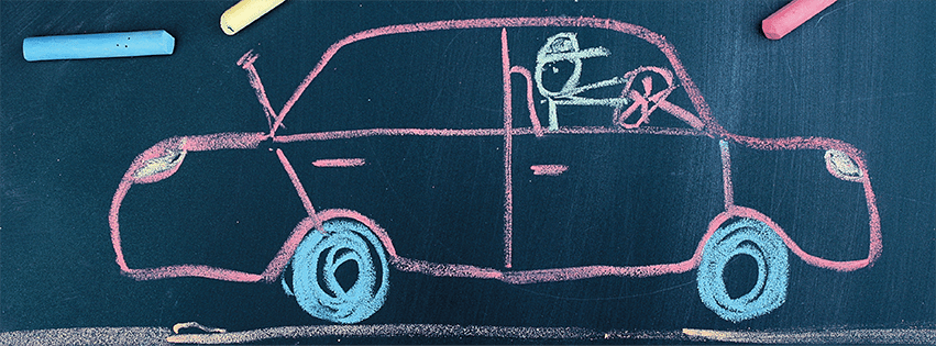 Car drawn on chalkboard with colored chalk.